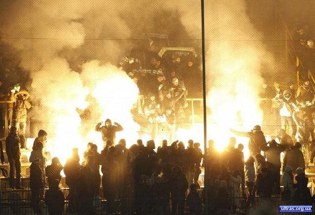 Fans of Karpaty Lviv's react during their Europa League soccer match against Paris Saint Germain in Lviv